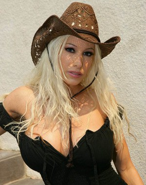 Blonde Gina Lynn strips out of cowgirl clothes in this hot photo set