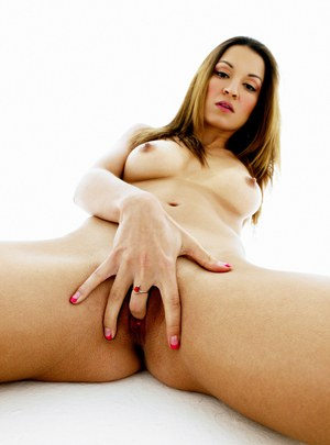 Ann Marie Rios poses nude and fingers her pussy