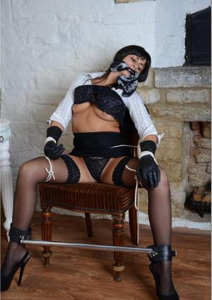 Busty Simone teases her master with her gorgeous leather gloves and silky nylons