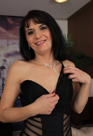 Horny Latina MILF Gracia Saluda looks stunning in thigh high stockings and a thong