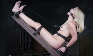 Endza Adair is locked down with legs spread wide hoping that all her captor is lying