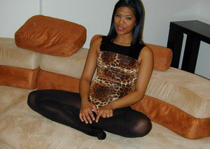 Emy Reyes is your naughty house kitten all dressed up in leopard print and ready