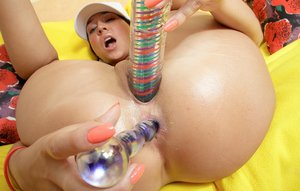 Olivia doubles up on her dildos and stuff her pussy and ass
